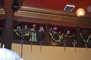 Tossing beads from the balcony at the Bossanova Ballroom